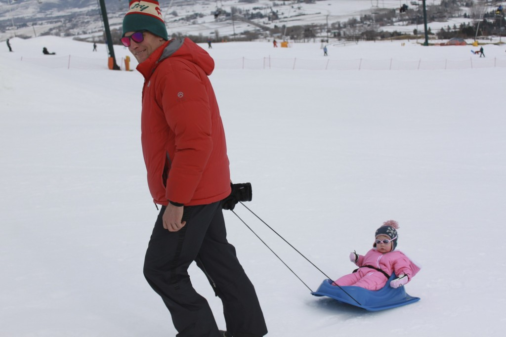 Dee Pulling M in Sled at Wolf Mountain