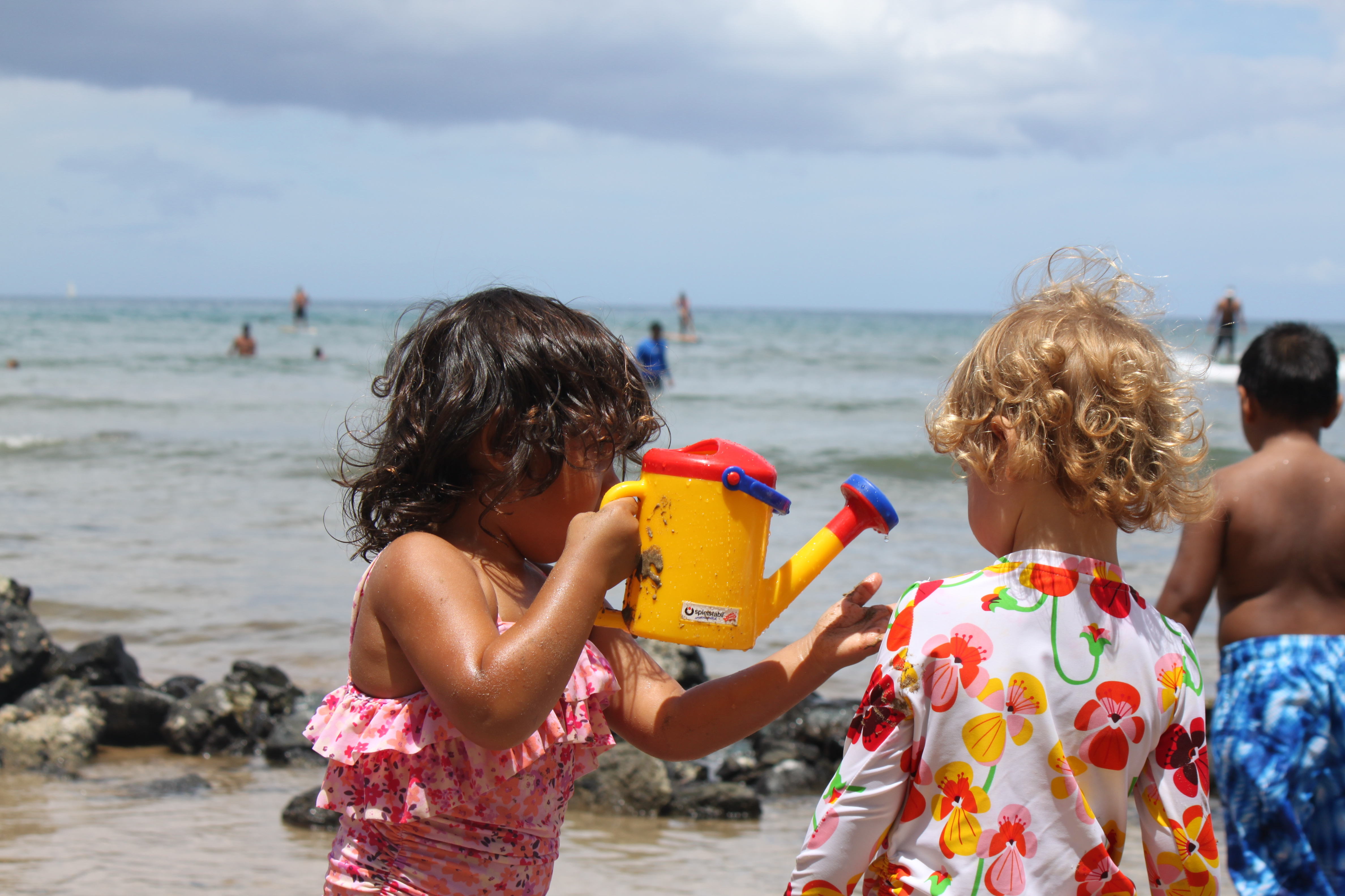 The Cove in Kihie girls watering the sand.